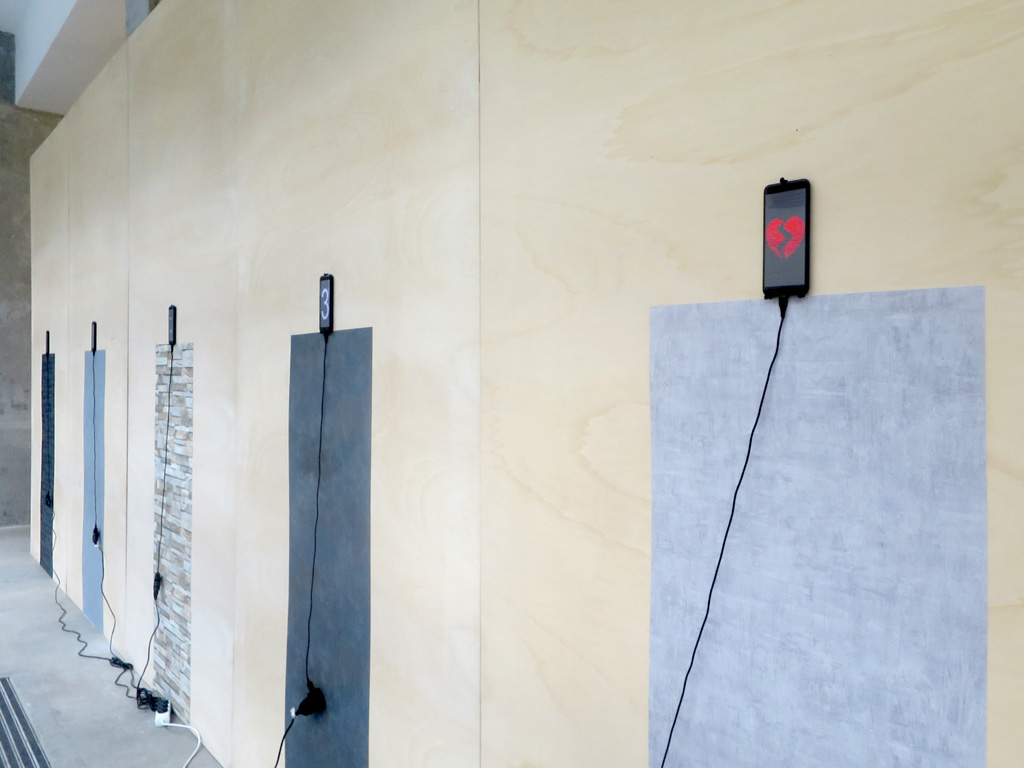Claude Closky, 'Direct Messages,' 2019, installation, 5 smartphones, wallpaper, power cables. Processing program by Jean-Noël Lafargue, 300 x 750 cm, unlimited duration.
