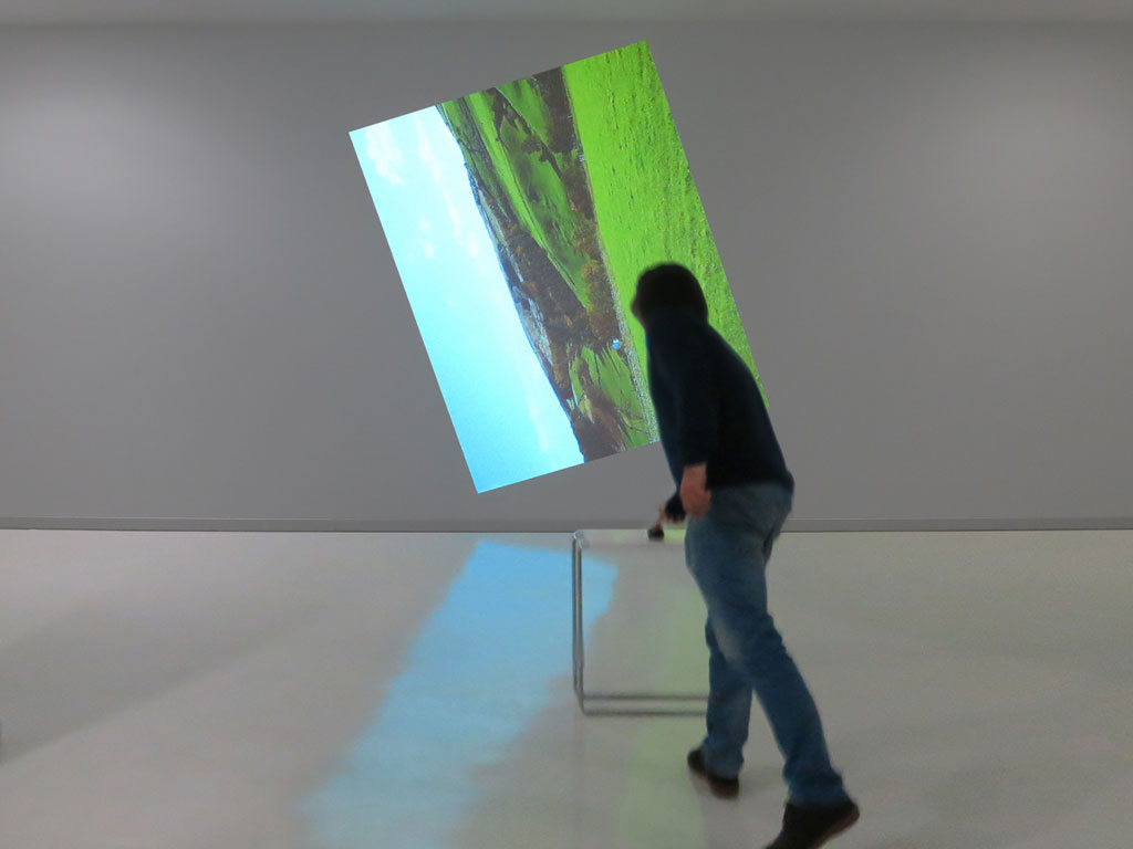 Claude Closky, 'Going Around In Circles (Essex)', 2013, interactive video installation, projector, stereo sound, computer, mouse, table, dimensions variable, unlimited duration. Data programming by Jean-Noël Lafargue. Exhibition view 'Dönüp durmak [Going Around in Circles]', Yeni Medya Sanatları Galerisi, Istanbul. 11 April - 1 June 2013. Curated by Ali Akay