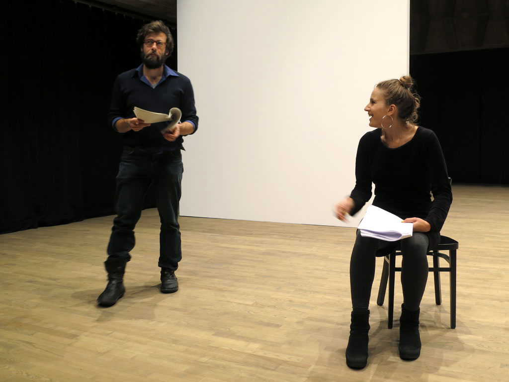"Claude Closky, 'Private View', 2006-11, staged by Yves Lefebvre, STUK Soetezaal, Leuven, 2012, invited by Steven Vandervelden. View of excerpt 4, Simon Allemeersch as Lawrence, Vanja Maria Godée as Barbara ""(...) Can I interest you in something in red (...)"". Photo Joséphine de Bère."