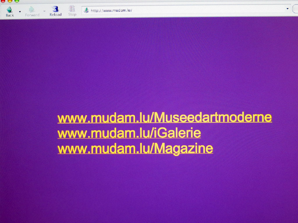 Claude Closky, 'www.mudam.lu', 2002, version 2.0. Conception and production of Mudam web site for the Grand-Duc Jean Museum of Modern Art Foundation, Luxembourg (museum activity, artist commissions, magazine).  Artist commissions: Emmanuelle Antille, Heath Bunting/Irational, François Curlet, Eric Maillet, Aleksandra Mir, David Shrigley. Contributors to the www.mudam.lu/Magazine: Carole Boulbès, Claude Closky, Jean de la Ciotat, Jean-Noël Lafargue, Simon Lamunière, Pierre Leguillon, Alexandra Midal, Sara Schnittjer Tucker, France Valliccioni. Publishing Director Marie-Claude Beaud, coordination Monica Portillo, Daniel Lesbaches, copy editor Laurence Lamare Sanchez, translation Jacques Bosser, Gail de Courcy-Ireland, Richard Crevier, Brian Holmes, Simon Pleasance.