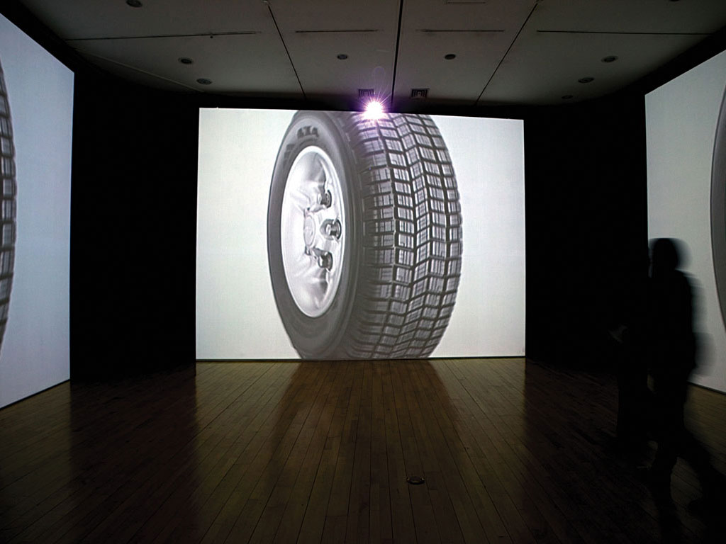Claude Closky, '4 X 4', 2005, 4 video projectors, 4 walls 450 x 600 cm, stereo amplifier & speakers, dvd, dvd player, variable dimensions, loop. Exhibition view 'Exchange value of pleasure', Museum of Modern Art, Busan. 5 December 2005 - 12 February 2006. Curated by Seon-Ryeong Cho
