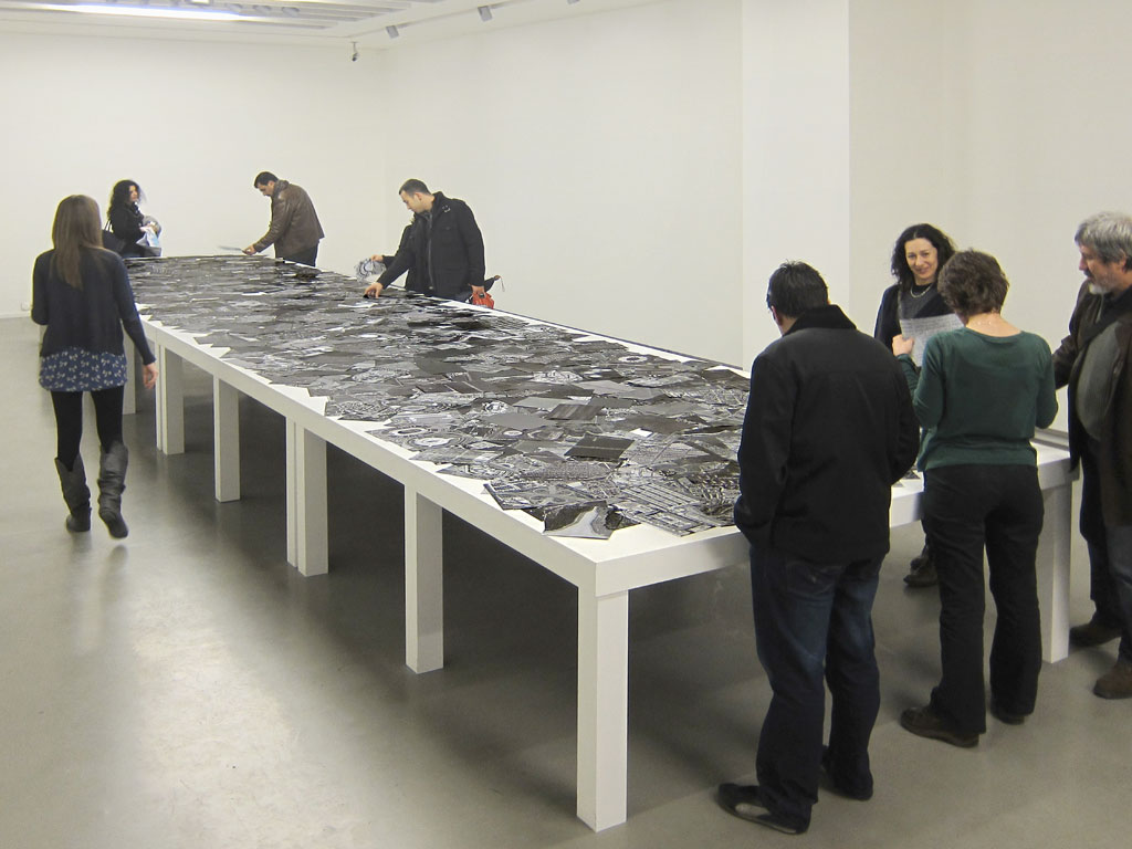 Claude Closky, 'A Flat World', 2009, black and white laser duplex printing, 80g A4 paper, table, 20 m2. Exhibition view 'Yazı mı Tura mı', Akbank Sanat, Istanbul. 16 January - 6 March 2010. Curated by Ali Akay