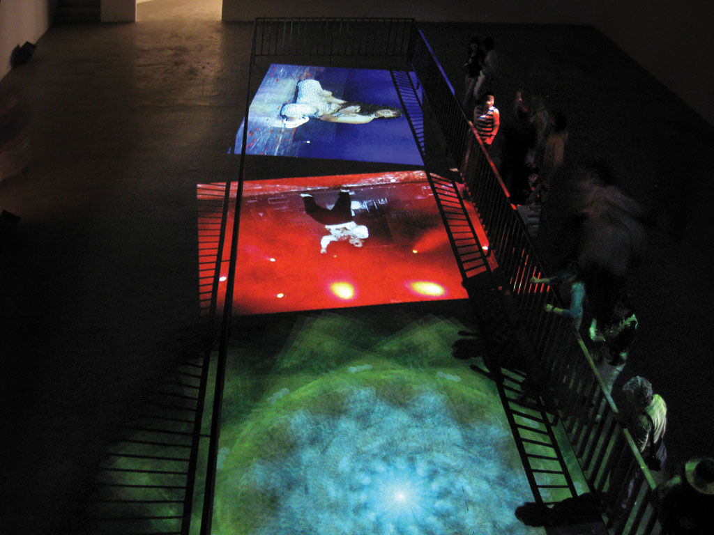 Claude Closky, 'Playing Guitar (Rick, Yosuke and Richie)', 2008, floor projection, 3 projectors, 3 computers, metallic barrier, stereo amplifier & speakers, variable dimensions, unlimited duration.