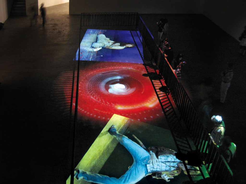 Claude Closky, 'Playing Guitar (Rick, Yosuke and Richie),' 2008, floor projection, 3 projectors, 3 computers, metallic barrier, stereo amplifier & speakers, variable dimensions, unlimited duration.
