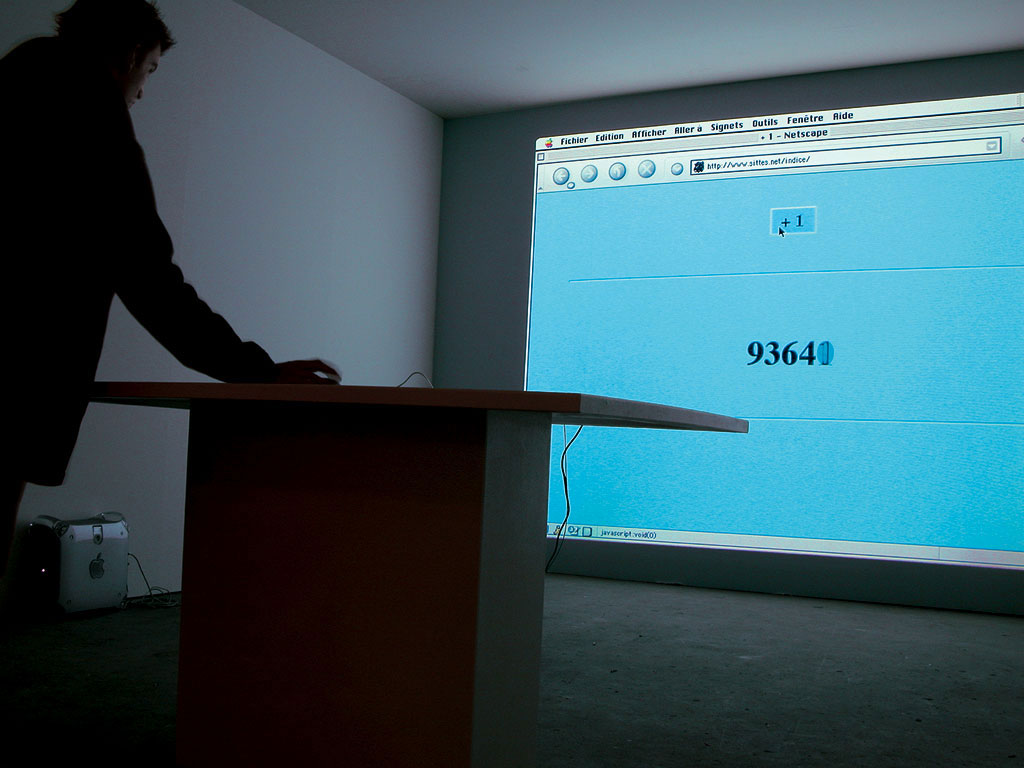 Claude Closky, '+1', 2000, projector, computer, table, mouse, permanent Internet connexion (http://www.sittes.net/indice), dimensions variable, unlimited duration. 'Experience, Foto Biënnale Rotterdam', Nederlands Fotomuseum, Rotterdam. 14 March - 21 April 2003. Curated by Frits Gierstberg, Bas Vroege