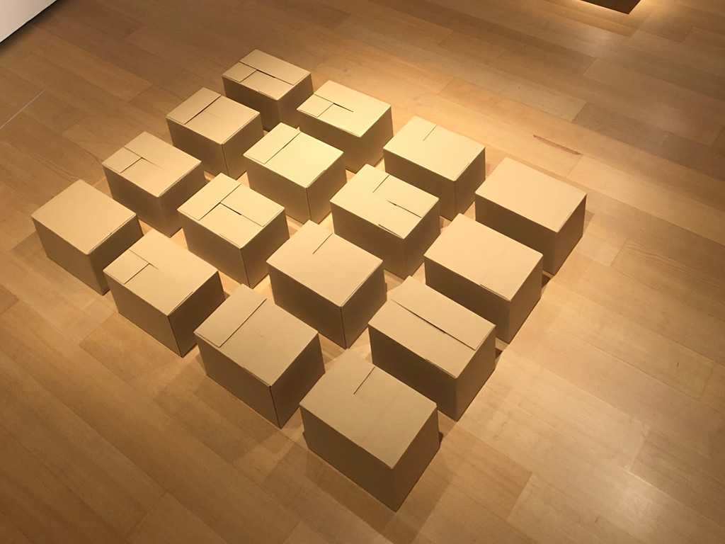 Claude Closky, 'All the ways to close a cardboard box,' 1989, 16 cardboard boxes, 50 x 500 x 800 cm. Exhibition view '1989. The End of the 20th Century,' IVAM, Valancia, 2019. Curated by Sandra Moros