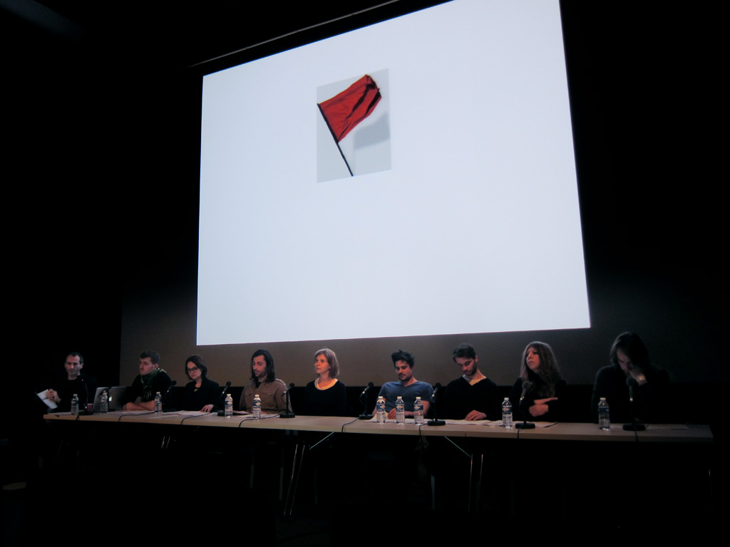Claude Closky, 'Bonnes réponses [Good Answers]', 1990-2011, performance for 9 actors, video projection, table, 9 chairs, 1 hour. 'Bonnes réponses', Centre Pompidou-Metz, Metz. 9 March 2011.  Invited by Hélène Guenin, Laurent Lebon, with Nicolas de Ribou, Sonia Derzypolski, Arnaud Dezoteux, Timothée Dufresne, Mathieu Junquet, Marianne Paul-Boncour, Alessandra Serra, Yan Tomaszewski
