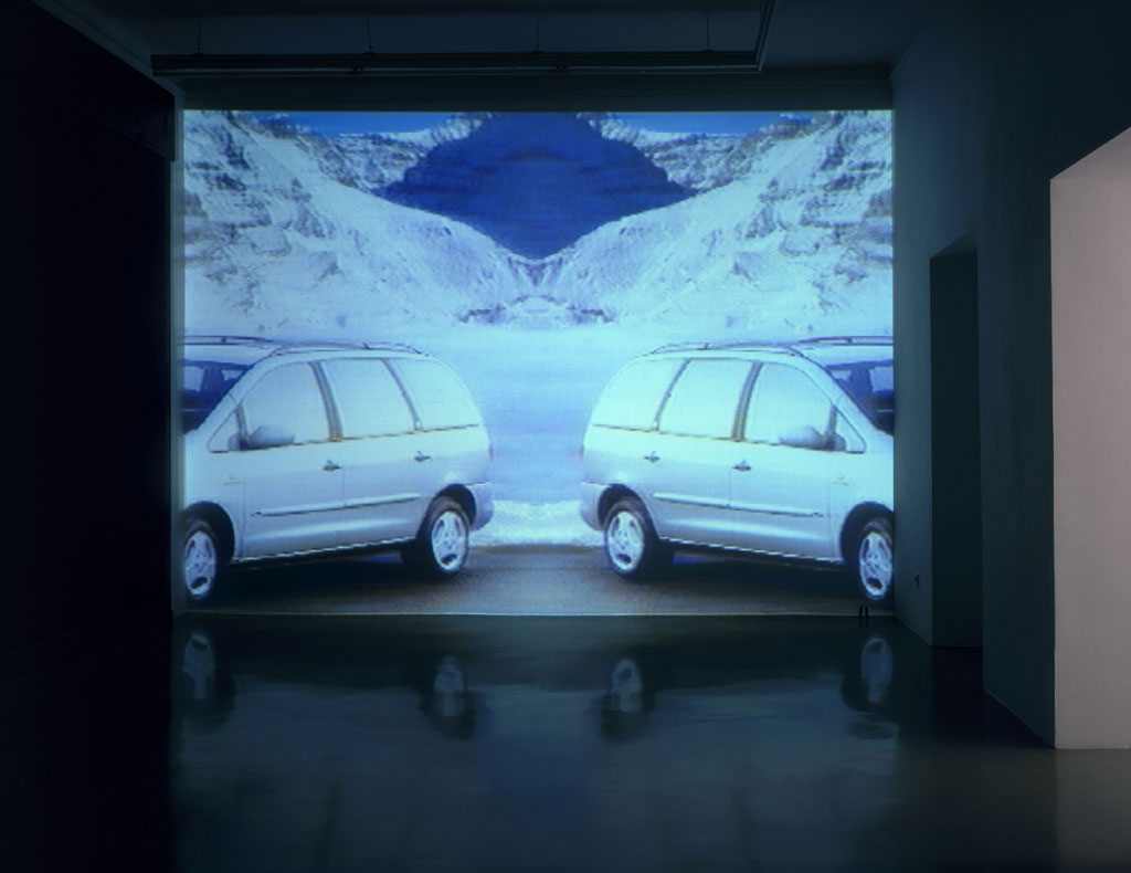 Claude Closky, 'Mountains and Mini-Vans ', 1997-1998, projector, dvd, dvd player, silent, wall-to-wall & floor-to-ceiling projection, unlimited duration. Exhibition view 'Fines de Claire', Galerie Mehdi Chouakri, Berlin. 20 June - 1 August 1998.